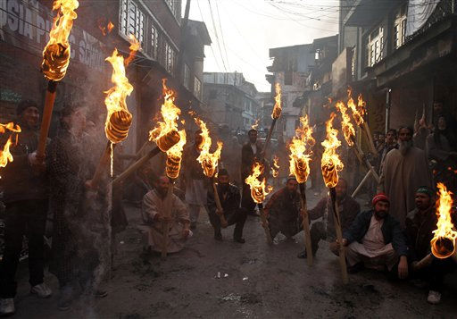 Activists of Jammu Kashmir Liberation Front hold torches during a protest march to mark International Human Rights Day in Srinagar, India, Friday, Dec. 10, 2010. &#40;AP Photo&#47;Mukhtar Khan&#41; <span class=meta>(AP Photo&#47; Mukhtar Khan)</span>