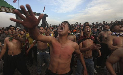 "<div class=""meta ""><span class=""caption-text "">Afghan Shiite Muslim beats their chests during Muharram procession in Kabul, Afghanistan, Sunday, Dec. 12, 2010. Muharram, the first month of the Islamic calendar is observed around the world for ten days of mourning in remembrance of martyrdom of Imam Hussein, the grandson of Prophet Mohammed. (AP Photo/Rafiq Maqbool) (AP Photo/ Rafiq Maqbool)</span></div>"