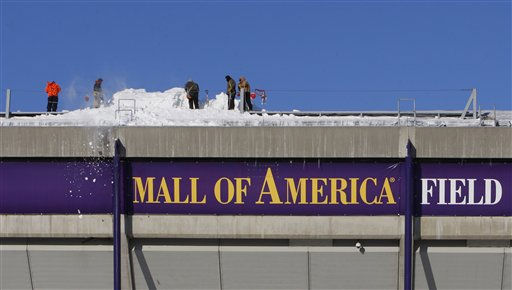 "<div class=""meta image-caption""><div class=""origin-logo origin-image ""><span></span></div><span class=""caption-text"">Workers shovel snow off the roof of Mall of America Field at the Hubert H. Humphrey Metrodome in Minneapolis Sunday, Dec. 12, 2010.  The inflatable roof of the Metrodome collapsed Sunday after a snowstorm that dumped 17 inches on Minneapolis. No one was hurt, but the roof failure sent the NFL scrambling to find a new venue for the Vikings' game against the New York Giants.(AP Photo/Ann Heisenfelt) (AP Photo/ Ann Heisenfelt)</span></div>"
