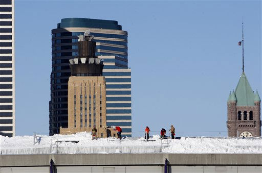 "<div class=""meta image-caption""><div class=""origin-logo origin-image ""><span></span></div><span class=""caption-text"">Workers shovel snow off the roof of Mall of America Field at the Hubert H. Humphrey Metrodome in Minneapolis Sunday, Dec. 12, 2010.  The inflatable roof of the Metrodome collapsed Sunday after a snowstorm that dumped 17 inches (43 cms) on Minneapolis. No one was hurt, but the roof failure sent the NFL scrambling to find a new venue for the Vikings' game against the New York Giants. (AP Photo/Ann Heisenfelt) (AP Photo/ Ann Heisenfelt)</span></div>"