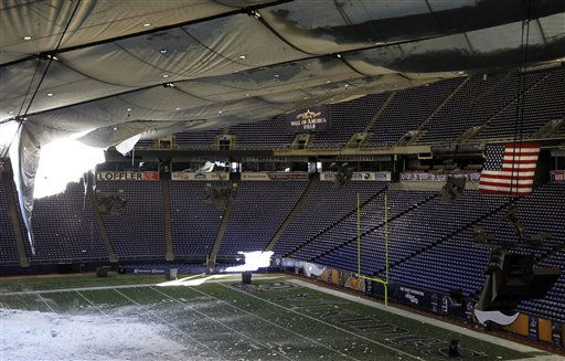 "<div class=""meta image-caption""><div class=""origin-logo origin-image ""><span></span></div><span class=""caption-text"">Snow falls into the field from a hole in the collapsed roof of the Metrodome in Minneapolis Sunday, Dec. 12, 2010.  The inflatable roof of the Metrodome collapsed Sunday after a snowstorm that dumped 17 inches (43 cms) on Minneapolis. No one was hurt, but the roof failure sent the NFL scrambling to find a new venue for the Vikings' game against the New York Giants. (AP Photo/Ann Heisenfelt) (AP Photo/ Ann Heisenfelt)</span></div>"