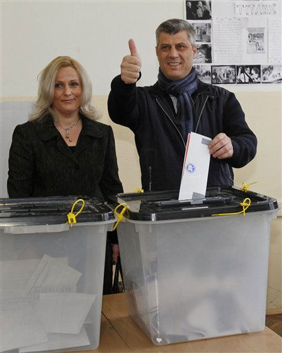 Leader of Democratic Party of Kosovo, PDK, Hashim Thaci joined by his wife Lumnije, gives a thumbs up as he casts his ballot in general elections in Kosovo&#39;s capital Pristina on Sunday, Dec. 12, 2010. Kosovars vote in the first general poll since the country&#39;s declaration of independence from Serbia in 2008, a critical election already marred by ethnic tension that many fear will split the world&#39;s newest country.&#40;AP Photo&#47;Visar Kryeziu&#41; <span class=meta>(AP Photo&#47; VISAR KRYEZIU)</span>