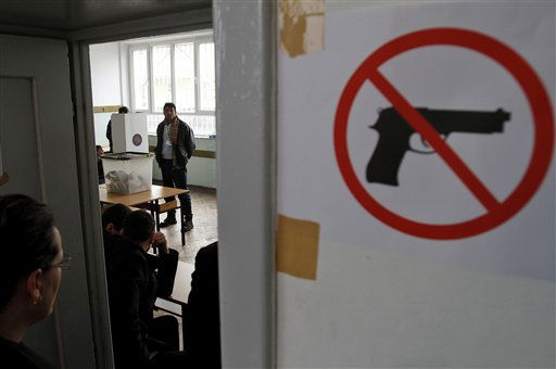 "<div class=""meta ""><span class=""caption-text "">People vote at a polling station in general elections in Kosovo's capital Pristina on Sunday, Dec. 12, 2010. Kosovars vote in the first general poll since the country's declaration of independence from Serbia in 2008, a critical election already marred by ethnic tension that many fear will split the world's newest country.(AP Photo/Visar Kryeziu) (AP Photo/ VISAR KRYEZIU)</span></div>"
