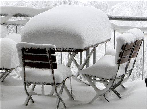 Snow covered tables and chairs stand outside a restaurant on top of the Feldberg mountain near Frankfurt, central Germany, on Tuesday, Dec. 14, 2010. &#40;AP Photo&#47;Michael Probst&#41; <span class=meta>(AP Photo&#47; Michael Probst)</span>