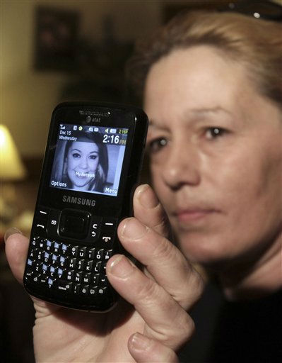 In this Dec. 15, 2010 file photo, Lorraine Ela of South Portland, Maine, displays her cell phone that has a picture of her daughter Megan Waterman, 22. Waterman was one of four women whose bodies were dumped along a desolate beachfront strip on Long Island. Authorities say all were prostitutes who booked their clients online and were probably slain by a serial killer.  &#40;AP Photo&#47;Pat Wellenbach, File&#41; <span class=meta>(AP Photo&#47; Pat Wellenbach)</span>