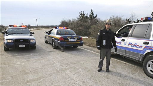 State and Suffolk County police block the entrance to Ocean Parkway near the area where four bodies were found earlier in the week, Thursday, Dec.16, 2010, on New York&#39;s Long Island. &#40;AP Photo&#47;Louis Lanzano&#41; <span class=meta>(AP Photo&#47; Louis Lanzano)</span>