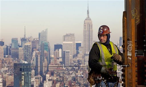 An ironworker looks at the New York skyline while working on a steel column for the 52nd floor of One World Trade Center, Thursday, Dec. 16, 2010 in New York. The tower is halfway to the 104 floors it will have upon completion, scheduled for 2013. The Empire State building is behind the ironworker. &#40;AP Photo&#47;Mark Lennihan&#41; <span class=meta>(AP Photo&#47; Mark Lennihan)</span>