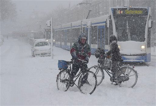A line of stranded trams is seen as bicyclists try and cross road in heavy snow in Amsterdam, Friday Dec. 17, 2010. The Dutch association of motorists, ANWB, the equivalent of AAA, called the traffic situation in the Netherlands &#34;chaotic&#34;. &#40;AP Photo&#47;Peter Dejong&#41; <span class=meta>(AP Photo&#47; PETER DEJONG)</span>