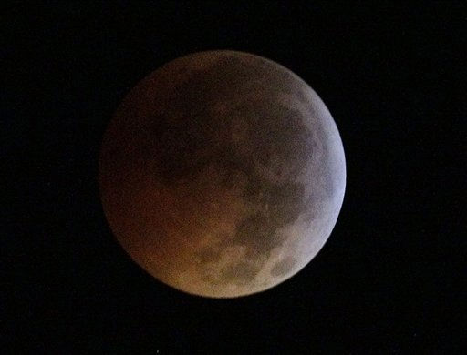 "<div class=""meta ""><span class=""caption-text "">The moon begins to turn a reddish color at 2:52 a.m. EDT during a total lunar eclipse, seen from Valrico, Fla., Tuesday, Dec. 21, 2010.  (AP Photo/Chris O'Meara) (AP Photo/ Chris O'Meara)</span></div>"