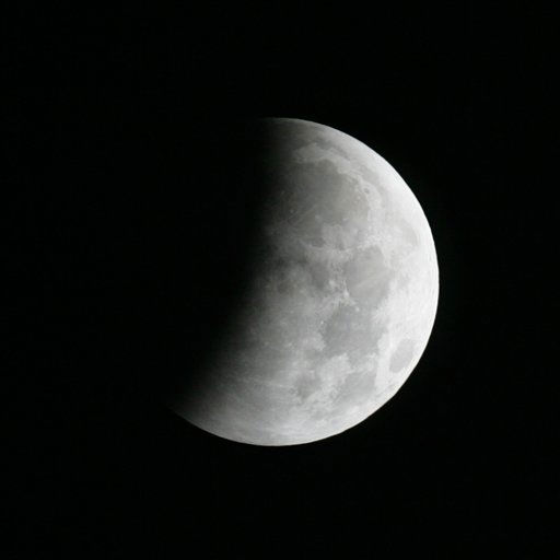 The Earth&#39;s shadow is cast over the surface of the Moon as a Lunar Eclipse proceeds though its partial phase in the sky over Tyler, Texas at 12:57 a.m. CST on Tuesday morning, Dec. 21, 2010.   &#40;AP Photo&#47;Dr. Scott M. Lieberman&#41; <span class=meta>(AP Photo&#47; Dr. Scott M. Lieberman)</span>