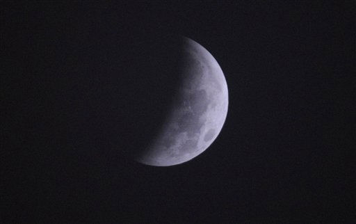 The Earth&#39;s shadow is cast over the surface of the Moon as a Lunar Eclipse proceeds though its partial phase in the sky over a cloudy and foggy San Antonio at 1:09 a.m. CST, Tuesday, Dec. 21, 2010. &#40;AP Photo&#47;Eric Gay&#41; <span class=meta>(AP Photo&#47; Eric Gay)</span>