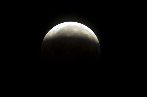 "<div class=""meta ""><span class=""caption-text "">The moon continues to emerge from a total Lunar Eclipse near Archer ,Fla., Tuesday, Dec. 21, 2010 at 4:15 a.m. EST. (AP Photo/Phil Sandlin) (AP Photo/ Phil Sandlin)</span></div>"