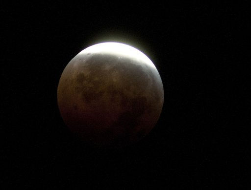 The moon begins to emerge from a total Lunar Eclipse at 4:04 a.m. EST near Gainesville ,Fla., Tuesday, Dec. 21, 2010,  &#40;AP Photo&#47;Phil Sandlin&#41; <span class=meta>(AP Photo&#47; Phil Sandlin)</span>