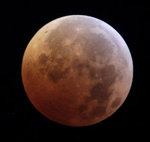 The moon is seen during a total lunar eclipse from New York, Tuesday, Dec. 21, 2010. A total lunar eclipse occurs when the Earth casts its shadow on the full moon, blocking the sun&#39;s rays that otherwise reflect off the moon&#39;s surface. Some indirect sunlight still pierces through to give the moon its reddish hue.  &#40;AP Photo&#47;Seth Wenig&#41; <span class=meta>(AP Photo&#47; Seth Wenig)</span>