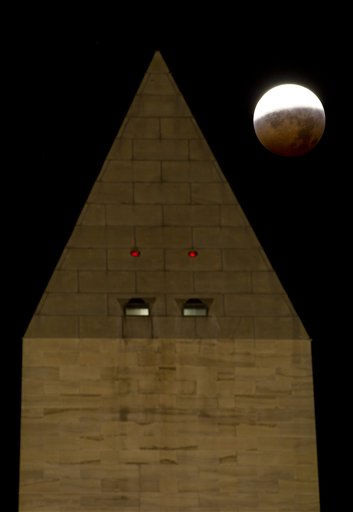 In a photo provided by NASA the Washington Monument is seen as the full moon is shadowed by the Earth during a total lunar eclipse on the arrival of the winter solstice, Tuesday, December 21, 2010 in Washington.  From beginning to end, the eclipse lasted about three hours and twenty-eight minutes.  &#40;AP Photo&#47;NASA&#47;Bill Ingalls&#41; <span class=meta>(AP Photo&#47; NASA&#47;Bill Ingalls)</span>