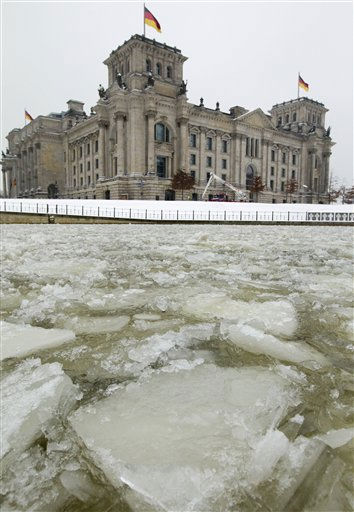 Ice floes accumulate on the river Spree next to the Reichstag building, which houses the German parliament Bundestag, in Berlin, Germany, Wednesday, Dec. 22, 2010. &#40;AP Photo&#47;Gero Breloer&#41; <span class=meta>(AP Photo&#47; Gero Breloer)</span>