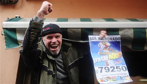 "<div class=""meta ""><span class=""caption-text "">A man celebrates after winning a portion the main prize of Spain's Christmas lottery with the number 79250 in Palleja, Spain, Wednesday, Dec. 22, 2010. Spain's beloved Christmas lottery known as ""El Gordo"" (The Fat One) spread euro2.3 billion ($3 billion) in holiday cheer Wednesday in a country facing 20 percent unemployment. This year, the top prize known, like the lottery itself, as El Gordo went to the number 79250. Tickets bearing that number were sold in the Madrid area, Barcelona, Alicante in the east and other cities ranging from the Basque region in the north to Tenerife in the Canary Islands. (AP Photo/Manu Fernandez) (AP Photo/ MANU FERNANDEZ)</span></div>"
