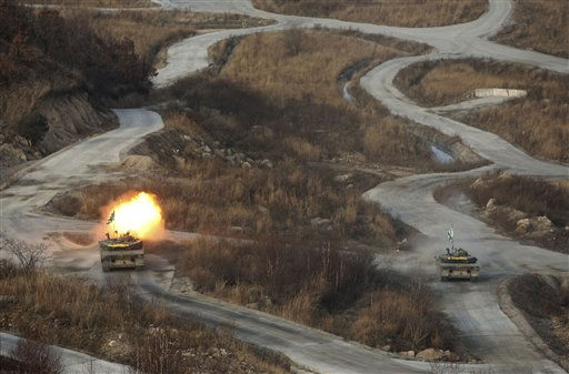 A South Korea&#39;s K-1 tank fires live rounds during the largest joint air and ground military exercises on the Seungjin Fire Training Field in mountainous Pocheon, 20 miles &#40;30 kilometers&#41; from the Koreas&#39; heavily fortified border, South Korea Thursday, Dec. 23, 2010.  South Korean fighter jets dropped bombs and tanks fired artillery Thursday as the military staged its largest air and ground firing drills of the year in a show of force a month after North Korea&#39;s deadly shelling of a front-line island. &#40;AP Photo&#47;Wally Santana, Pool&#41; <span class=meta>(AP Photo&#47; Wally Santana)</span>