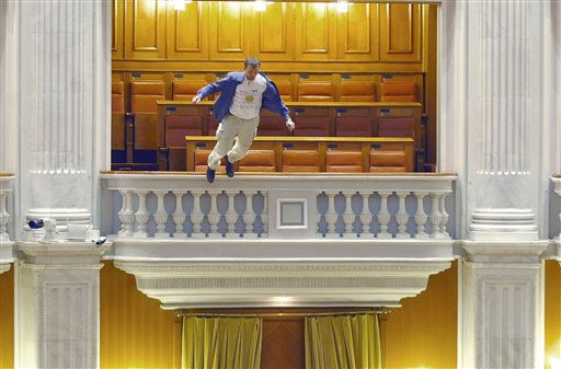 Adrian Sobaru, an electrician at the national television station throws himself from a balcony in Romania&#39;s Parliament, Thursday, Dec. 23, 2010, just as the prime minister began to speak ahead of a no-confidence vote. Sobaru suffered fractures to the face, and other non life-threatening injuries, according to a hospital official.&#40;AP Photo&#47;Bogdan Stamatin&#47;Mediafax Foto&#41; ROMANIA OUT: CREDIT MANDATORY <span class=meta>(AP Photo&#47; Bogdan Stamatin)</span>