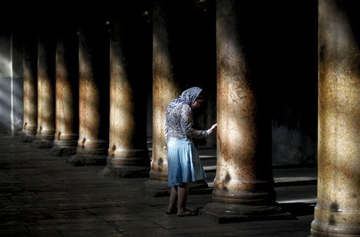 "<div class=""meta ""><span class=""caption-text "">A Russian tourist touches a column inside the Church of the Nativity, where many Christians believe Jesus Christ was born, in the West Bank town of Bethlehem, Thursday, Dec. 23, 2010. So far this year, 1.4 million tourists have visited the traditional birthplace of Jesus and 90,000 are expected during the Christmas season, a significant increase over last year, according to Israeli government figures. The numbers of visitors have been rising steadily in recent years. (AP Photo/Tara Todras-Whitehill) (AP Photo/ Tara Todras-Whitehill)</span></div>"