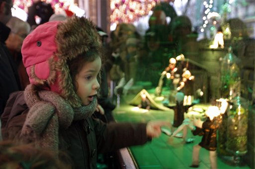 A girl looks at Christmas decorations in a store window, in Paris, Thursday, Dec. 23,  2010. &#40;AP Photo&#47;Jacques Brinon&#41; <span class=meta>(AP Photo&#47; Jacques Brinon)</span>