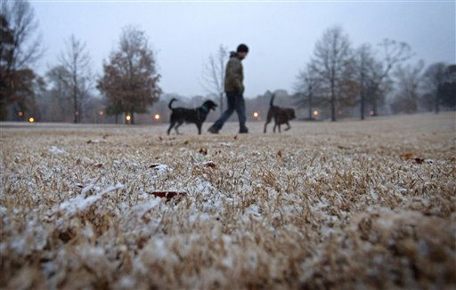 Aaron Curtis, of Atlanta, walks through the snow with his dogs, Boone, left, and Einstein, in Atlanta&#39;s Piedmont Park Saturday, Dec. 25, 2010. Snow, sleet and icy rain began falling Saturday morning in some parts of north Georgia, and the wintry mix descended on metro Atlanta in the afternoon. &#40;AP Photo&#47;David Goldman&#41; <span class=meta>(AP Photo&#47; David Goldman)</span>