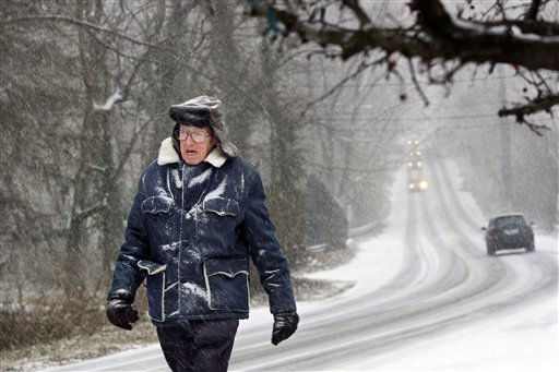Roland Lippincott, 92, walks in the snow along a rural road near Yardley, Pa., Sunday, Dec. 26, 2010. &#40;AP Photo&#47;Mel Evans&#41; <span class=meta>(AP Photo&#47; Mel Evans)</span>