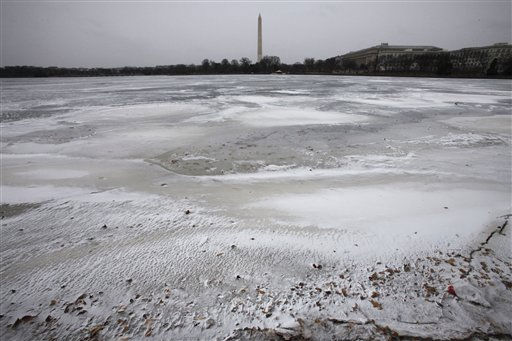 The tidal basin is iced over with the Washington Monument in the background in Washington, on Sunday, Dec. 26, 2010. &#40;AP Photo&#47;Jacquelyn Martin&#41; <span class=meta>(AP Photo&#47; Jacquelyn Martin)</span>