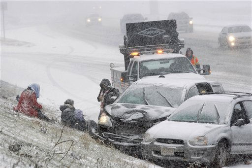 People wait for help as they sit on a hill in a heavy snowfall near cars that collided on Rt.295 Sunday, Dec. 26, 2010, in Columbus, N.J. &#40;AP Photo&#47;Mel Evans&#41; <span class=meta>(AP Photo&#47; Mel Evans)</span>