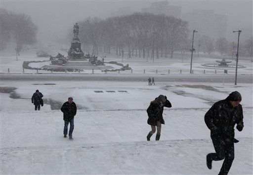 Unidentified tourists from Finland run up the so-called  &#34;Rocky Steps&#34;,  made famous in the original &#34;Rocky&#34; movie, in front of the Philadelphia Museum of Art during a blowing snowstorm Sunday, Dec. 26, 2010.  &#40;AP Photo&#47;Jacqueline Larma&#41; <span class=meta>(AP Photo&#47; Jacqueline Larma)</span>