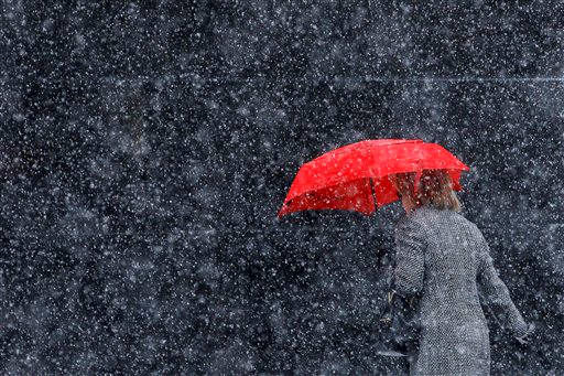 "<div class=""meta image-caption""><div class=""origin-logo origin-image ""><span></span></div><span class=""caption-text"">A woman walks along Broad Street during a winter storm, Sunday, Dec. 26, 2010, in Philadelphia. (AP Photo/Matt Slocum)</span></div>"