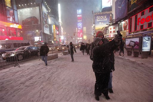 Kristy and Kieran Strangman, of Cranberra, Australia, take a photo of themselves during a blowing snowstorm, Sunday, Dec. 26, 2010 in New York&#39;s Times Square. &#40;AP Photo&#47;Mary Altaffer&#41; <span class=meta>(AP Photo&#47; Mary Altaffer)</span>