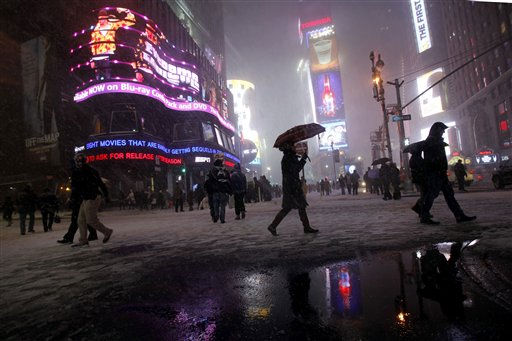 People walk along Broadway during a blowing snowstorm, Sunday, Dec. 26, 2010 in New York&#39;s Times Square. &#40;AP Photo&#47;Mary Altaffer&#41; <span class=meta>(AP Photo&#47; Mary Altaffer)</span>