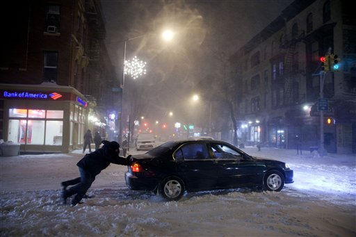 People help push a car through an icy intersection Sunday evening in the Park Slope section of the Brooklyn borough of New York, Dec. 26, 2010. &#40;AP Photo&#47;Mark Lennihan&#41; <span class=meta>(AP Photo&#47; Mark Lennihan)</span>