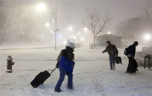 People walk through the snow in the Brooklyn borough of New York, Sunday evening, Dec. 26, 2010. &#40;AP Photo&#47;Mark Lennihan&#41; <span class=meta>(AP Photo&#47; Mark Lennihan)</span>