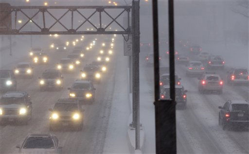 "<div class=""meta ""><span class=""caption-text "">Cars creep along the Long Island expressway during a blizzard in New York, Sunday, Dec. 26, 2010.  (AP Photo/Seth Wenig) (AP Photo/ Seth Wenig)</span></div>"