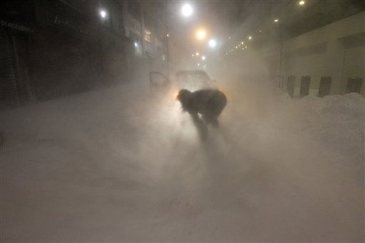Karina Chernes, 22, of North Bergen, N.J. attempts to dig her car through a downtown Newark, N.J. street as snow continued to come down, Monday, Dec. 27, 2010. &#40;AP Photo&#47;Julio Cortez&#41; <span class=meta>(AP Photo&#47; Julio Cortez)</span>