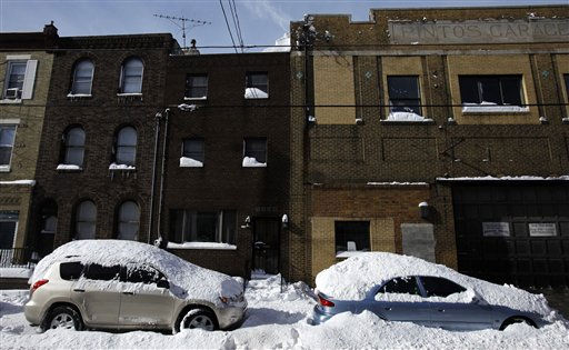Cars covered in snow are shown in the aftermath of a winter storm, Monday, Dec. 27, 2010, in Philadelphia. &#40;AP Photo&#47;Matt Slocum&#41; <span class=meta>(AP Photo&#47; Matt Slocum)</span>