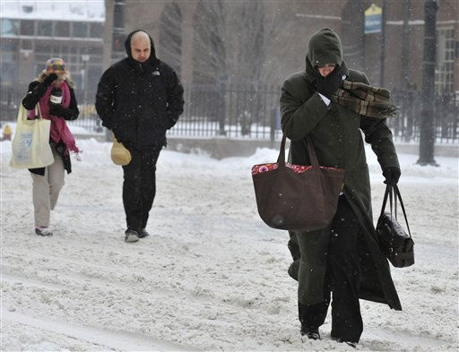 Pedestrians cross the street as a winter storm continues in Hartford, Conn., Monday, Dec. 27, 2010.  &#40;AP Photo&#47;Jessica Hill&#41; <span class=meta>(AP Photo&#47; Jessica Hill)</span>