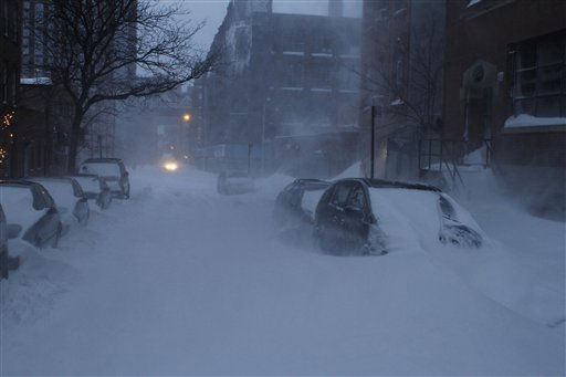 "<div class=""meta ""><span class=""caption-text "">Snow is swept around by the wind on Front St. in the Brooklyn borough of New York, Monday Dec. 27, 2010. A powerful East Coast blizzard menaced would-be travelers by air, rail and highway Monday, leaving thousands without a way to get home after the holidays and shutting down major airports and rail lines for a second day. (AP Photo/James H. Collins) (AP Photo/ Janes H. Collins)</span></div>"