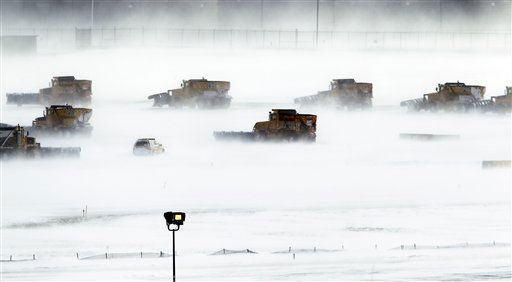 Snow removal crews work to clear runways at Philadelphia International Airport  in Philadelphia, Monday, Dec. 27, 2010.  A powerful East Coast blizzard menaced would-be travelers by air, rail and highway Monday, leaving thousands without a way to get home after the holidays and shutting down major airports and rail lines for a second day. &#40;AP Photo&#47;Matt Rourke&#41; <span class=meta>(AP Photo&#47; Matt Rourke)</span>