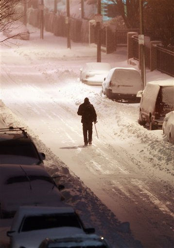 A lone pedestrian walks in the street in the East Boston neighborhood of Boston, Monday, Dec. 27, 2010, in Boston. &#40;AP Photo&#47;Michael Dwyer&#41; <span class=meta>(AP Photo&#47; Michael Dwyer)</span>