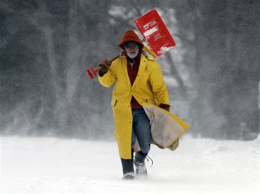 Leo Picone, of Brunswick, Maine, braves the wintry weather as snow swirls around him as he makes his way along a road in Brunswick, Maine, to shovel out customers  on Monday, Dec. 27, 2010. The weather service reported that coastal areas of the state received up to a foot of snow. &#40;AP Photo&#47;Pat Wellenbach&#41; <span class=meta>(AP Photo&#47; Pat Wellenbach)</span>