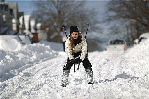 Justine Kasztelan, 17, of Kearny, N.J., practices winter sports downhill on a street in her neighborhood the morning following a snow storm, Monday, Dec. 27, 2010. &#40;AP Photo&#47;Julio Cortez&#41; <span class=meta>(AP Photo&#47; Julio Cortez)</span>