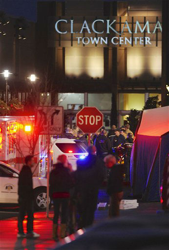 "<div class=""meta ""><span class=""caption-text "">Police and medics outside the scene of a multiple shooting at Clackamas Town Center Mall in Clackamas, Ore., Tuesday Dec. 11, 2012. A gunman is dead after opening fire in the Portland, Ore., area shopping mall Tuesday, killing two people and wounding another, sheriff's deputies said. (AP Photo/Greg Wahl-Stephens) (AP Photo/ Greg Wahl-Stephens)</span></div>"
