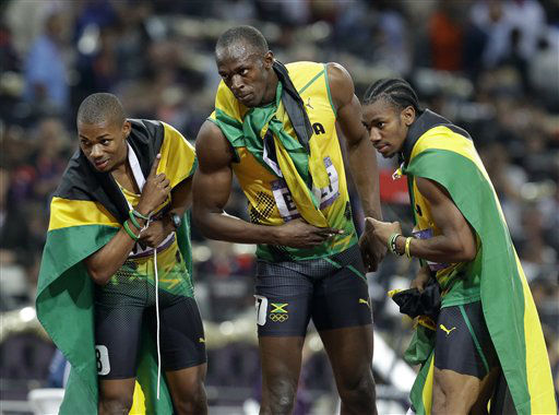 "<div class=""meta ""><span class=""caption-text "">Jamaica's gold medal winner Usain Bolt, center, celebrates with his teammate Warren Weir, left, and Yohan Blake after the men's 200-meter final during the athletics in the Olympic Stadium at the 2012 Summer Olympics, London, Thursday, Aug. 9, 2012. (AP Photo/Lee Jin-man) (AP Photo/ Lee Jin-man)</span></div>"