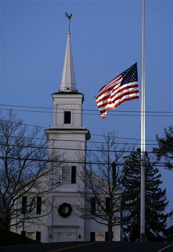 An American flag flies at half-staff as dawn breaks, Saturday, Dec. 15, 2012 in Newtown, Conn.  A gunman walked into Sandy Hook Elementary School in Newtown Friday and opened fire, killing 26 people, including 20 children. &#40;AP Photo&#47;Jason DeCrow&#41; <span class=meta>(AP Photo&#47; Jason DeCrow)</span>
