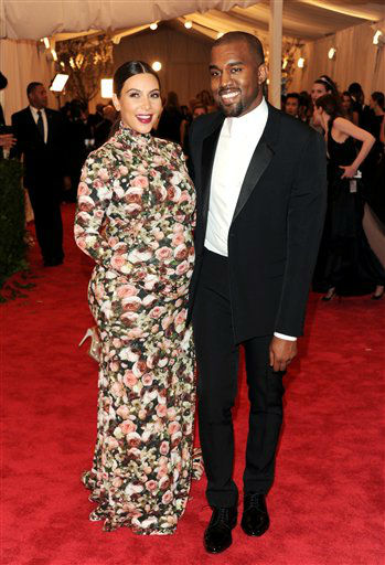 "Kim Kardashian and Kanye West attend The Metropolitan Museum of Art Costume Institute gala benefit, ""Punk: Chaos to Couture"", on Monday, May 6, 2013 in New York. (Photo by Evan Agostini/Invision/AP)"