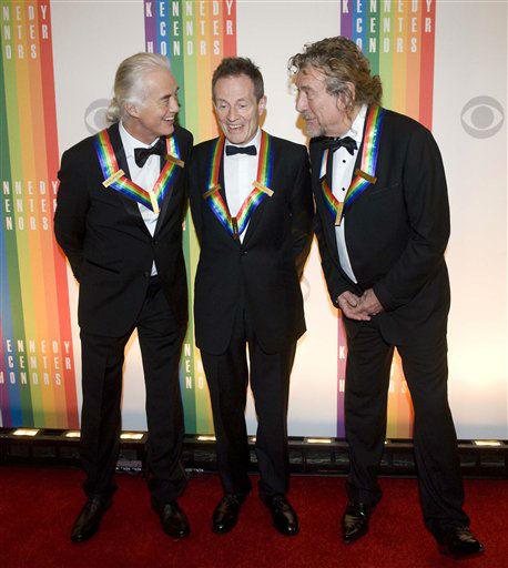 "<div class=""meta ""><span class=""caption-text "">2012 Kennedy Center Honorees and members of the band Led Zeppelin, from left, Jimmy Page, John Paul Jones, and Robert Plant chat on the red carpet after arriving at the Kennedy Center for the Performing Arts for the 2012 Kennedy Center Honors Performance and Gala Sunday, Dec. 2, 2012 at the State Department in Washington. (AP Photo/Kevin Wolf) (AP Photo/ Kevin Wolf)</span></div>"