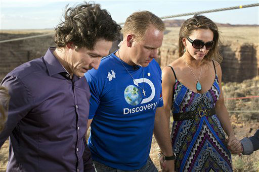 IMAGE DISTRIBUTED FOR DISCOVERY COMMUNICATIONS - Preacher Joel Osteen, left, leads prayer with Nik and Erendira Wallenda ahead of Nik&#39;s 1400 foot walk across the Grand Canyon for Discovery Channel&#39;s Skywire Live With Nik Wallenda on Sunday, June 23, 2013 at the Grand Canyon, Calif. &#40;Tiffany Brown&#47;AP Images for Discovery Communications&#41; <span class=meta>(Photo&#47;Tiffany Brown)</span>